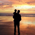 Father give his son a hug (Table of Contents)