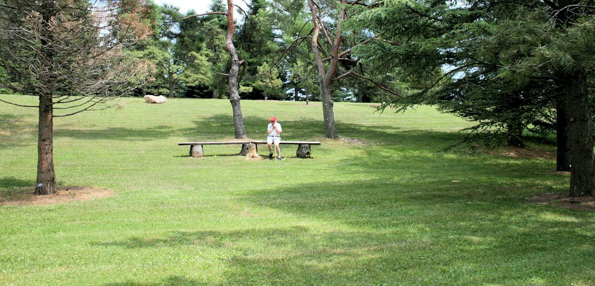 man sitting on bench in park waiting for God's compassion like a Prodigal Son