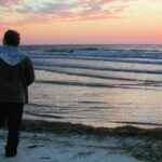 man alone on beach at sunset (Table of Contents)